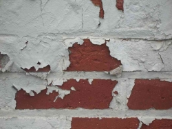 Flaking Paint Leaves Brick Exposed